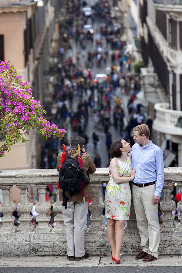 Portrait session on the balcony of the Spanish steps. Standing next to a tourist.