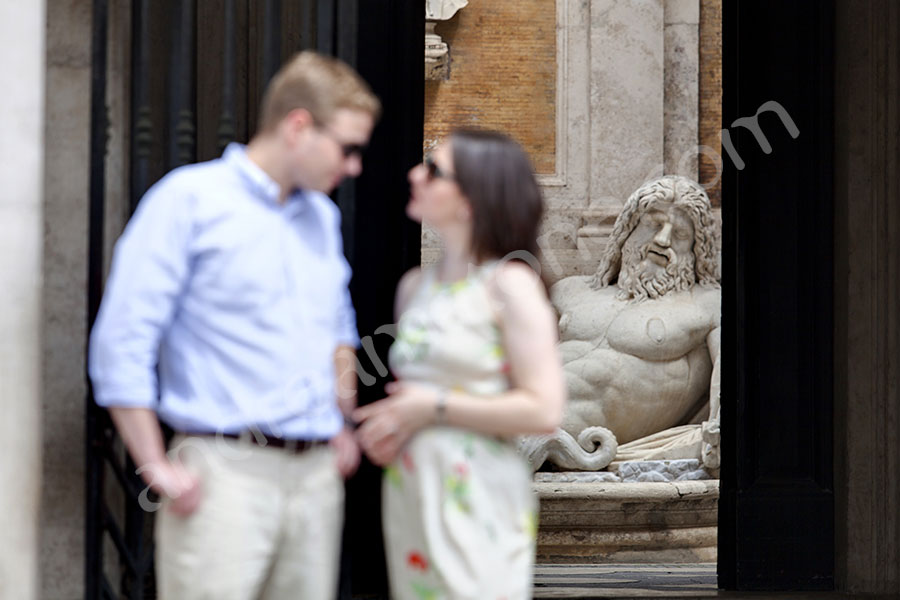 Engaged and out of focus effect in front of the statue in Piazza del Campidoglio