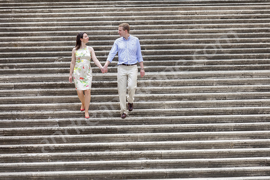 Walking hand in hand down the stairs Piazza del Campidoglio