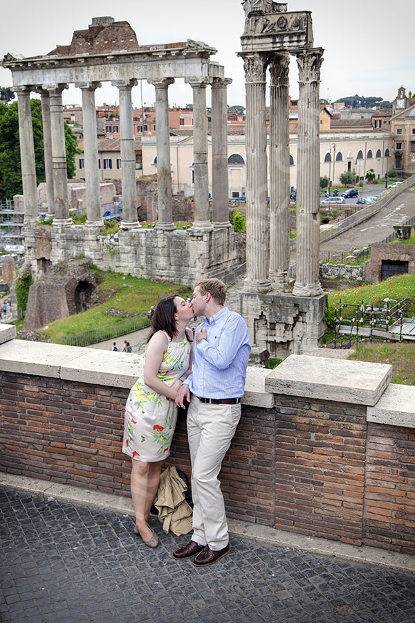 Kissing among ancient Italian ruins. Forum. Engagement photographers in Rome Italy.