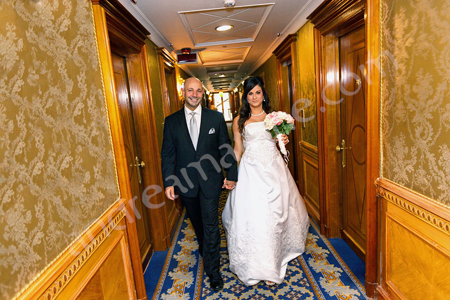 newlyweds walking hand in hand inside Hotel Parco dei Principi