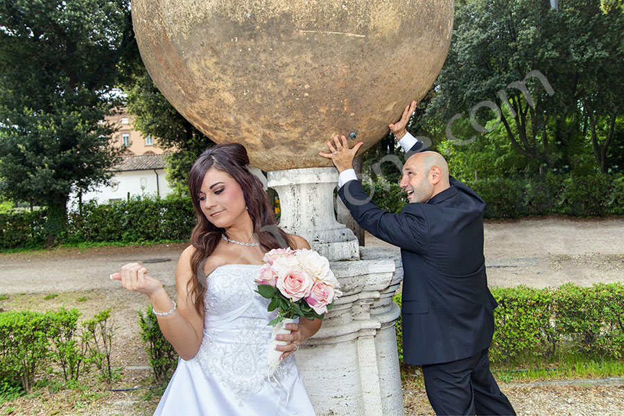 Groom holding a great deal of weight. Rome wedding photo shoot.