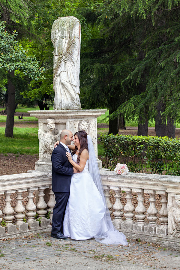 Galleria Borghese Park. newlyweds posing for a picture.