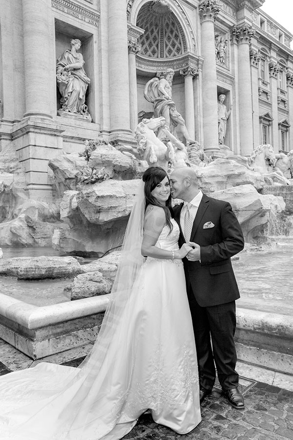 Newlyweds in Piazza Fonanta di Trevi during. Black and white image.