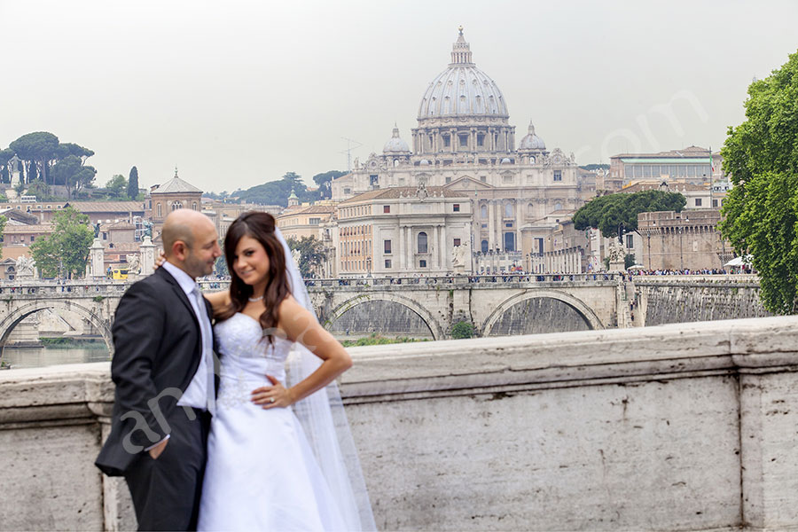 Wedding couple on Ponte Umberto in Rome with Saint Peter's in the distance