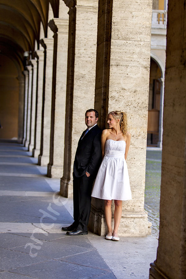 Newlyweds posing at San Ivo alla Sapienza in the city center