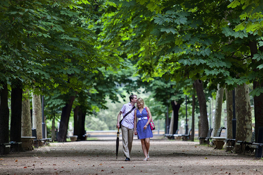 Walking in Parco Villa Borghese during an engagement session