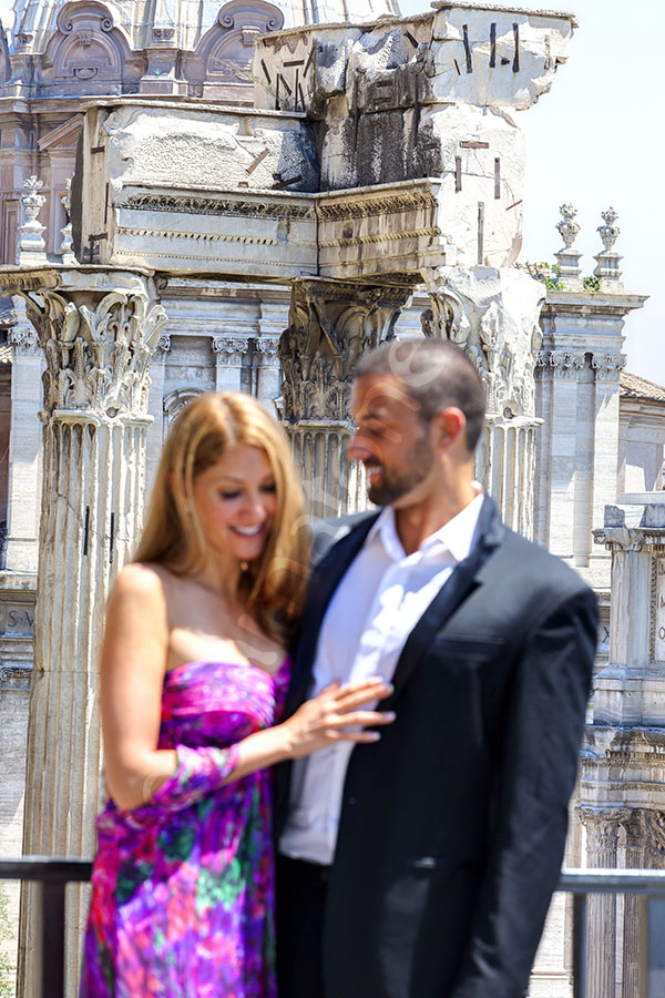 The Roman forum photographed from above with a a beautiful couple out of focus