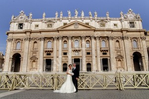 Wedding couple photographed in front of Saint Peter's Basilica in the Vatican Rome Italy