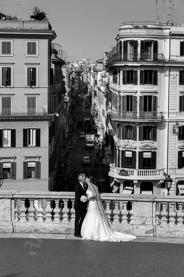 Newlyweds at the Spanish steps taking blakc and white pictures