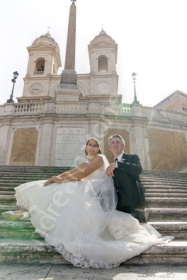 Bride and groom sitting down on the Spanish steps and soaking some nice sunlight
