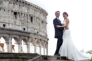 Wedding couple photographed in front of the Roman Coliseum in Rome