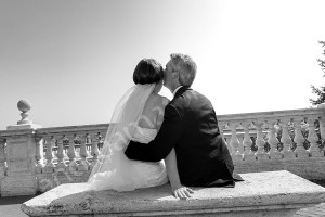 Wedding couple sitting down by an overlooking view of Rome