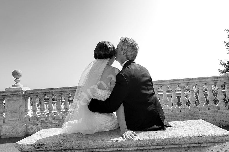Bride and groom sitting down an overlooking the stunning view from Gianicolo