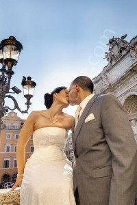 Wedding couple photographed while kissing by the Trevi fountain in Rome