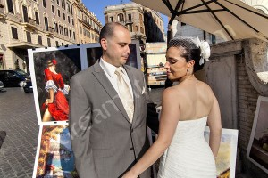 Wedding newlyweds standing among paintings in Piazza Trinita' dei Monti in Rome Italy
