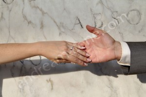 Couple just married holding hands showing wedding rings