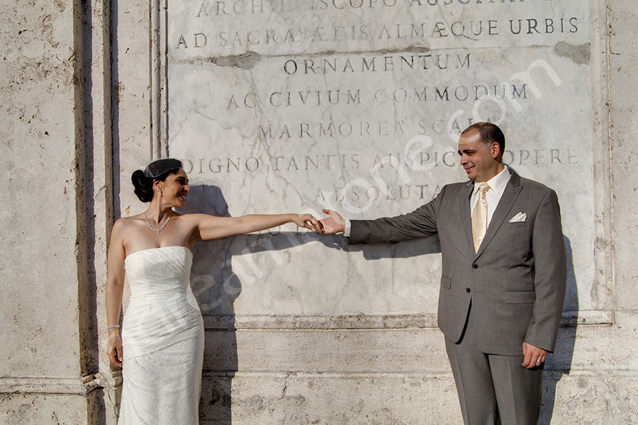 Bride and groom and their gesture in Piazza di Spagna