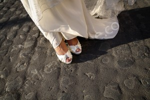 The bride's wedding shoes and dress