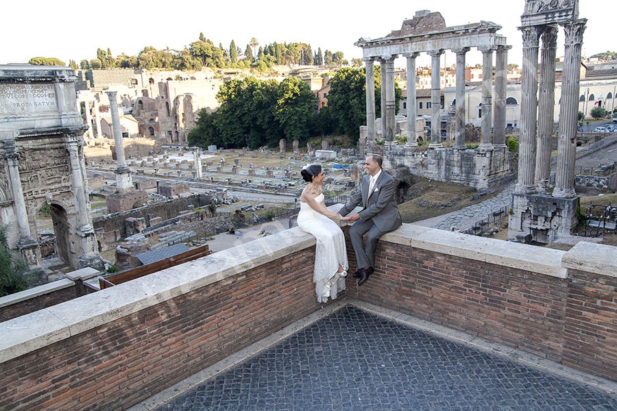 Newlyweds sitting down and chatting at the Roman Forum