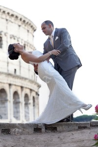 Groom dipping bride over in front of the Colosseum in Rome Italy