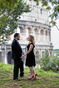 Couple on a honeymoon posing in front of the Roman Colosseum