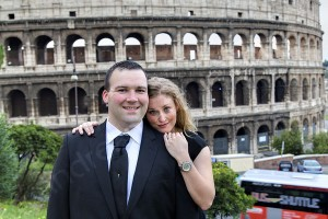 Couple posing during a photo shoot session in Rome Italy in front of the Roman Colosseum