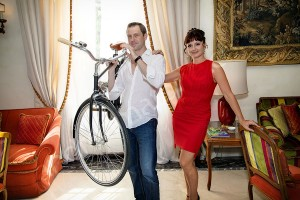 Man holding bike before going out for a photo shoot in Rome with a photograher