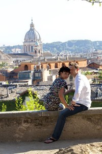 Married couple photographed in front of Rome's rooftops
