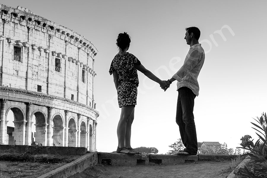 Standing in front of the Roman Coliseum looking away. Black and white picture.
