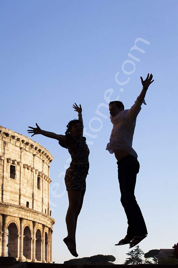 Best engagement photographers in Rome Italy. Couple jumping in front of the Roman Colosseum