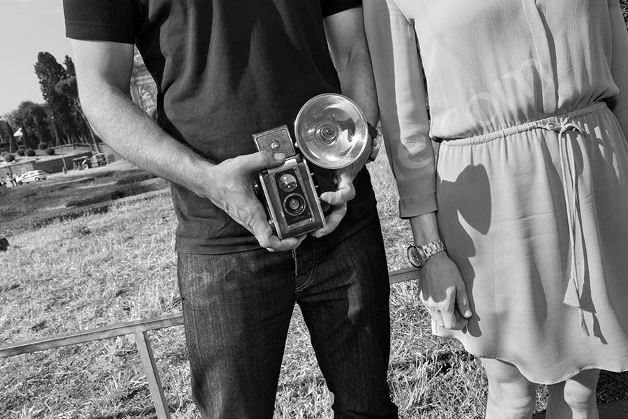 Holding a vintage kodak camera during a session