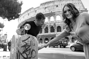 Couple drinking from a water fountain in Rome during a photo shoot