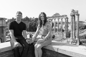 Couple posing and sitting for a portrait picture at the roman Forum