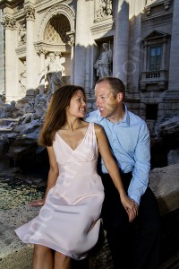 Couple together posing at Piazza Fontana di Trevi in Rome Italy