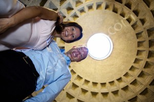 Standing inside the Roman Pantheon with a picture of the hole above