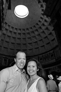 The hole above a couple photographed in black and white in Rome
