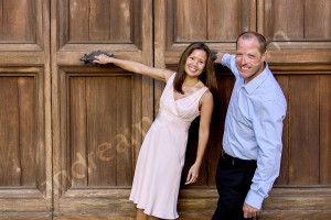 Dynamic portrait picture of a couple by a door in Rome Italy