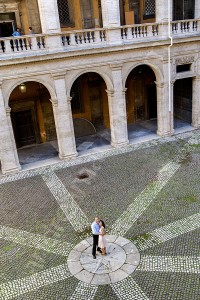Couple during a visit in Rome photographed as they are visiting San Ivo alla Sapienza