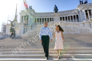 Couple walking down the white stairs on the Vittoriano monument in Rome