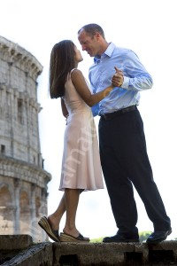 Couple holding each other by the Roman Coliseum
