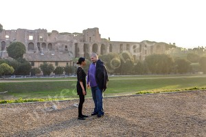 Couple standing photographed on top of Circo Massimo in Rome Italy