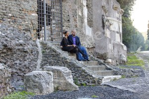Couple sitting down and relaxing during a photographer session in Rome on ancient Appia