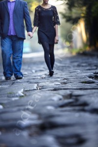 Couple walking together hand in hand on the ancient Appia road in Rome Italy