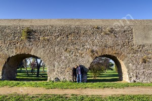 Couple photographed at the ancient roman aqueduct Appio Claudio