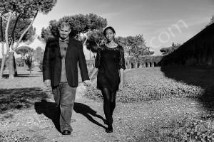 Couple walking together ancient roman aqueduct Appio Claudio Rome Italy
