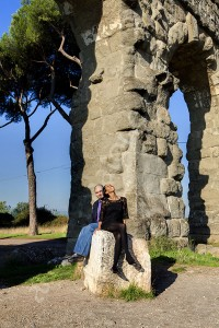 Engagement couple photo looking up at the plane below the aqueduct in Appio Claudio park in Rome Italy