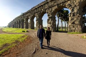 Couple walking during a photo tour Appio Claudio Park Rome Italy