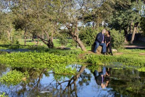 Couple kissing during a photo session with a professional photographer in Rome Appio Claudio park