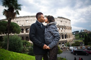 Kissing in front of the Roman Colosseum in the city of Rome Italy